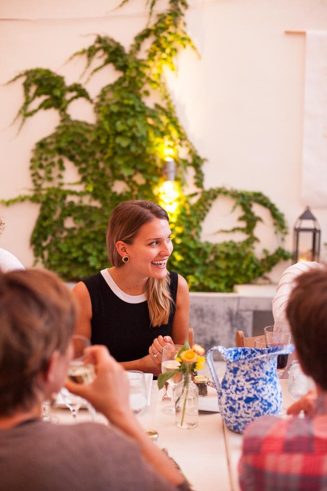 smiling woman at a wedding at the maas building