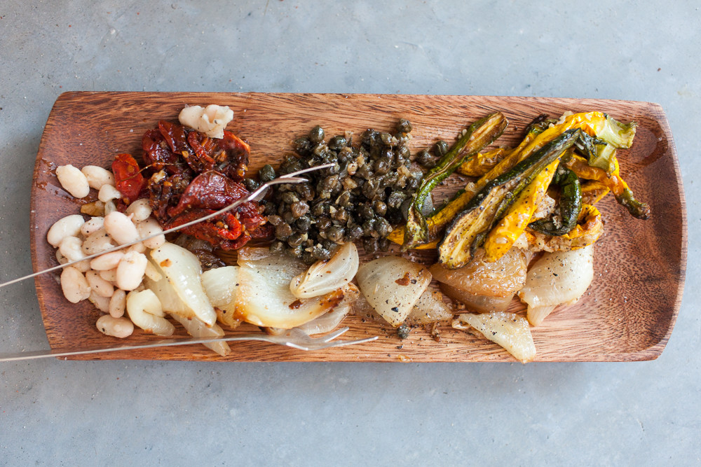 roasted vegetables on a bamboo plate made by birchtree catering
