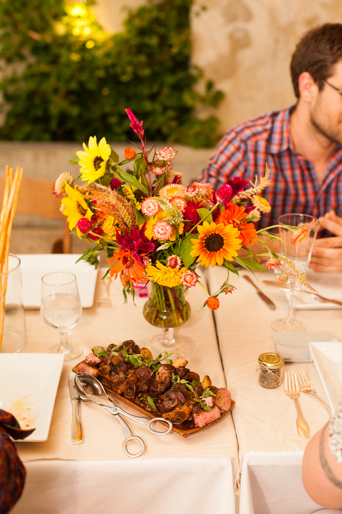 wildflower bouquet and braised lamb shank by birchtree catering at the maas building