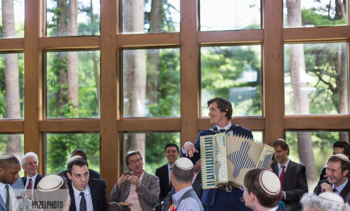 isabella freedman wedding - a man playing accordion at a tisch