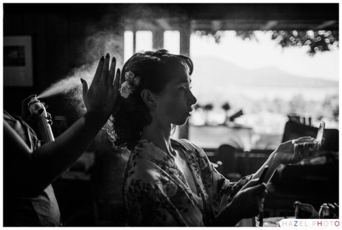Bride having hairspray applied at an ashokan dreams wedding. Documentary wedding photography