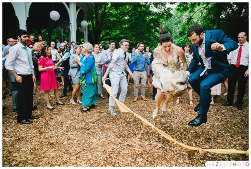 Bride and groom jumping rope at an awbury arboretum for a wedding. Documentary wedding photography