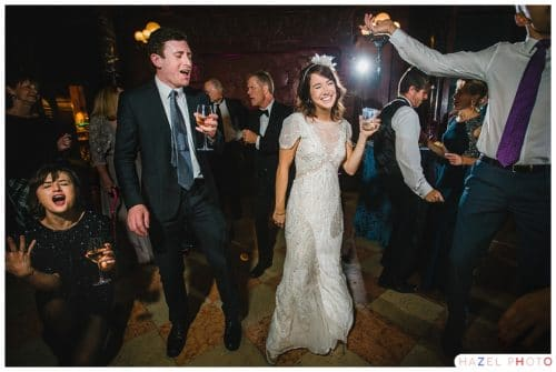 bride with a big smile on her face on the dance floor surrounded by excellent dancers. Documentary wedding photography