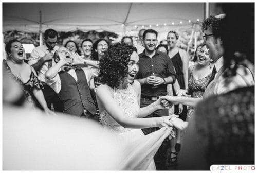 Bride dancing with groom surrounded by adoring friends at an Isabella Freedman wedding Documentary wedding photography