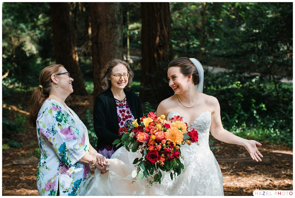 A bride laughing with her aunts at Stern Grove